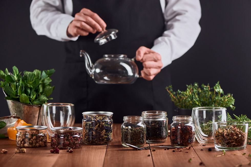 Glass jars with various sorts of tea, he