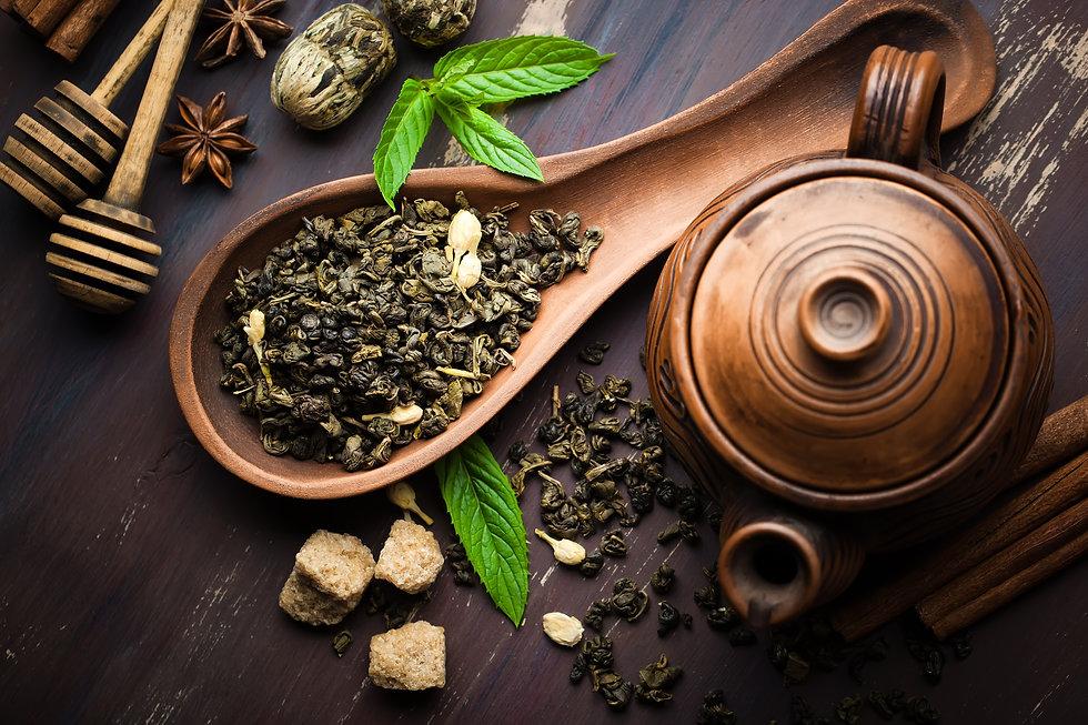 Dried tea leaves with tea pot.jpg