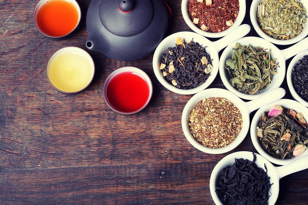 assortment of dry tea on wooden backgrou
