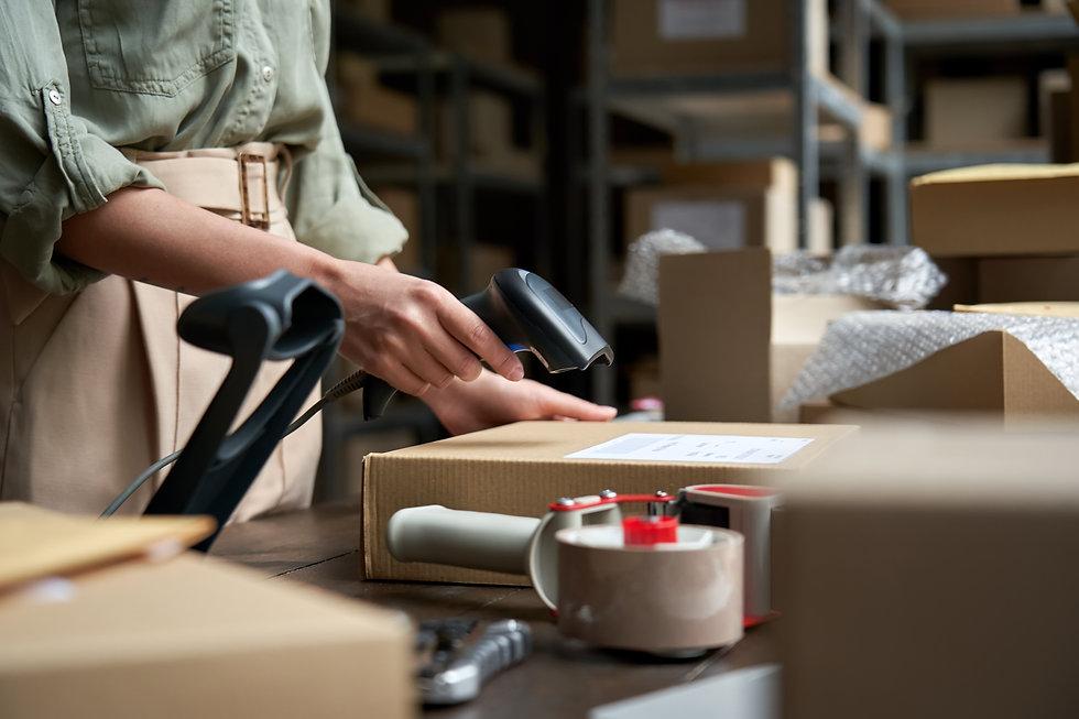 Female seller online store worker holdin