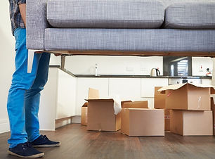 man lifting couch at home.jpg