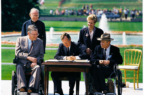 President George H.W. Bush signed Americans with Disability Act (ADA)