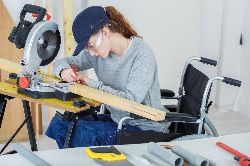Woman with disability working in manufacturing environment
