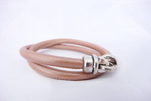 Bracelet cuir rond surpiqué doré rose