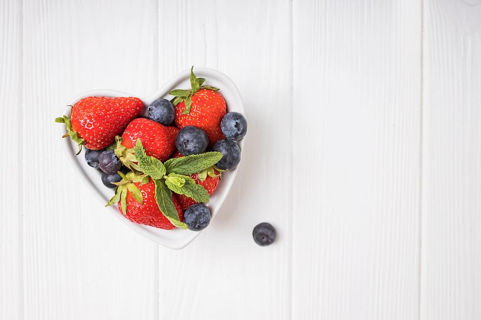 Freshstrawberriesandblueberriesinheartsh