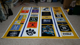 Queen size racing stripe sashing in a Custom style T-shirt quilt.