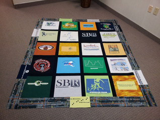 Twin size Block Style with print border and black sashing T-shirt quilt.