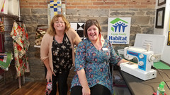 Tricia Kerr and Stephanie showcasing the Habitat for Humanity Charity Quilt!