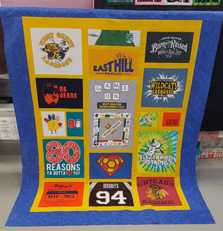 Lap size Custom style with yellow sashing and blue border T-shirt quilt.