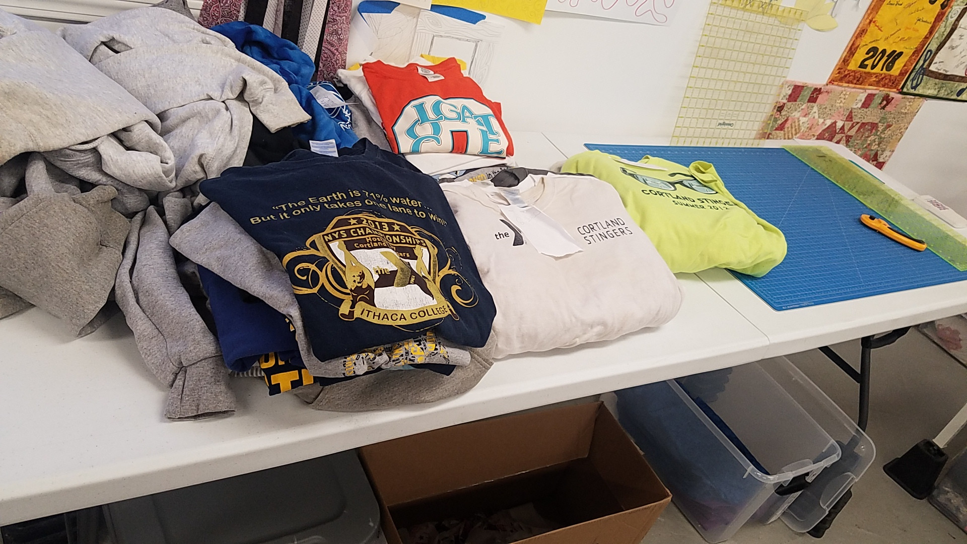 Client's piles of T-shirts