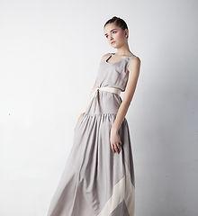 Woman in grey long dress