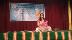 Kiranavali giving a talk