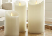 armonie trio of pillar candles on wooden circular tray in adelaide australia
