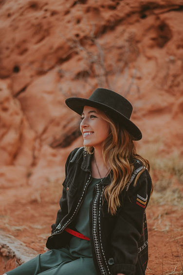 Broken Antler Photography lead photographer and owner Alexa Johnson, women in a black outfit and black hat in the desert, headshot, women's headshot, Colorado elopement and wedding photographer