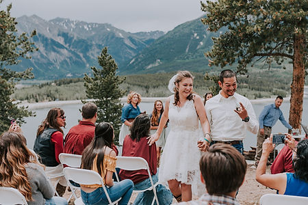 Bride and groom leaving ceremony, mountain wedding ceremony, intimate Colorado wedding, Colorado intimate wedding photography, Twin Lakes wedding