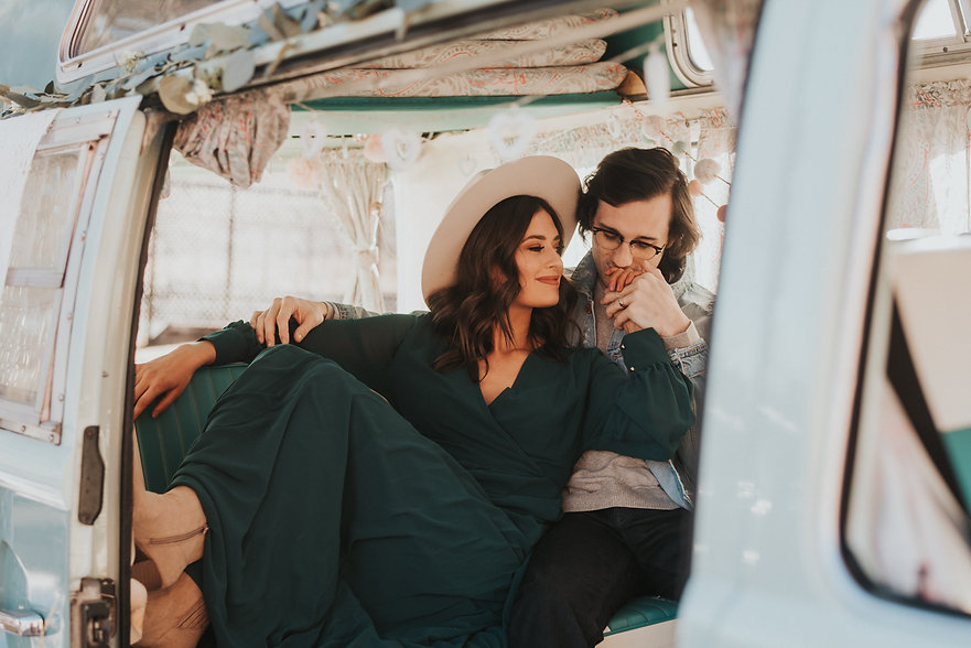 Romantic boho couple snuggling in a teal bus, romantic engagement photos, boho mountain engagement, Colorado engagement photography, Colorado couples photography