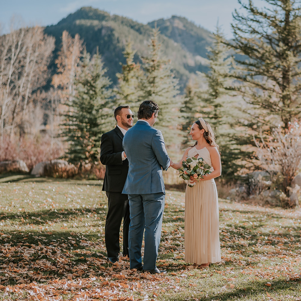 Bride and Groom Exchanging Vows in John Denver Sanctuary in Aspen, Mountain Elopement Location