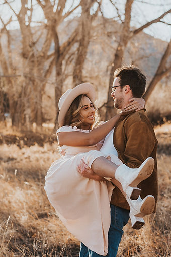 Man holding a woman smiling, romantic couples photos, Colorado couples photography, Colorado couples session, outdoor couples photos