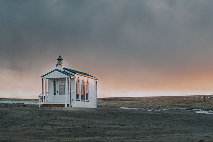 Little white church in the sunset, pink sunset at a Colorado Springs wedding venue, Colorado farm wedding venue, wedding venue