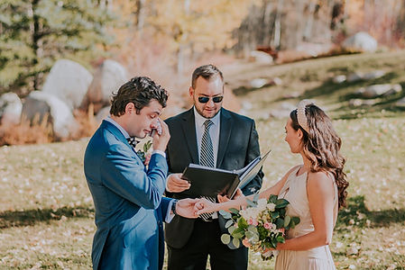 Groom crying during ceremony while holding brides hand, Aspen bride and groom, wedding ceremony, Colorado wedding photography, intimate wedding photography