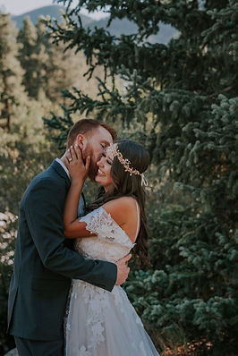 Bride and groom kissing in the woods, Woodland wedding portraits in Frisco, CO, Mountain wedding portraits