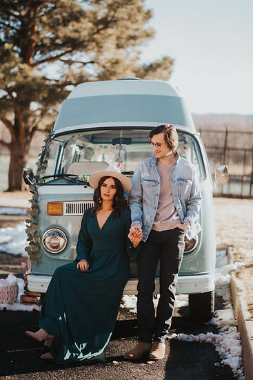 Boho couple holding hands in front of a teal VW bus, boho couples session, Colorado couples photography, outdoor couples photos