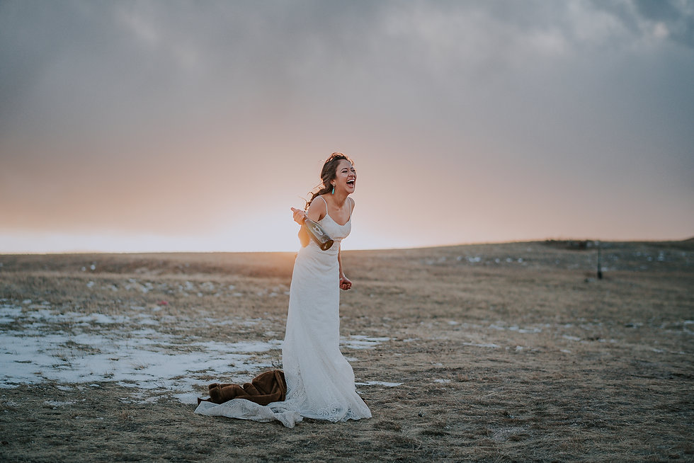 Rustic bride at a Colorado farm venue popping champagne and laughing, happy bride, bride at sunset, Colorado bridal portrait, Colorado wedding photography