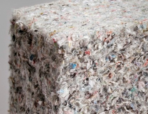 Blown-in Insulation in older homes was made out of shredded paper and cardboard, a perfect host for Morgellons.  The Speckled colors look alot like Morgellons fibers as well.