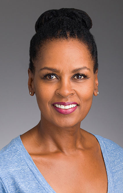 African-American woman smiling with a blue shirt