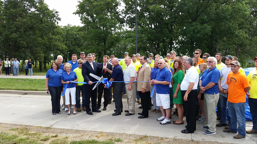 Members of the Jefferson City Chamber of Commerce join, from left, State Technical College Board of Regents president John Klebba, State Treasurer Clint Zweifel, State Technical College president Donald Claycomb, State Representative Dave Schatz, and State Senator Mike Kehoe for the ribbon cutting ceremony at the State College of Missouri renaming ceremony July 1, 2014.