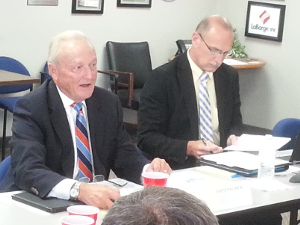 Fred Palmer (left) representing Peabody Coal makes a point as AIM president Ray McCarty takes notes at the AIM lunch and learn Thursday, 8/22.