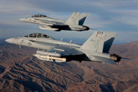 """A pair of Boeing EA-18G Growlers, XE 573 166857 and XE 571 166855 of the VX-9 """"Vampires"""" cruise over the desert. Image purchased 2/14/2011  RMS 200428"""