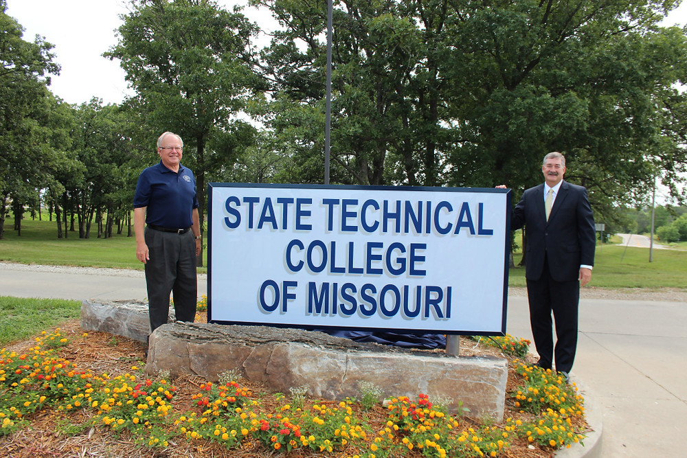 State Technical College of Missouri president Donald Claycomb (left) and Board of Governors chairman John Klebba show off the new sign welcoming guests to the college in Linn.