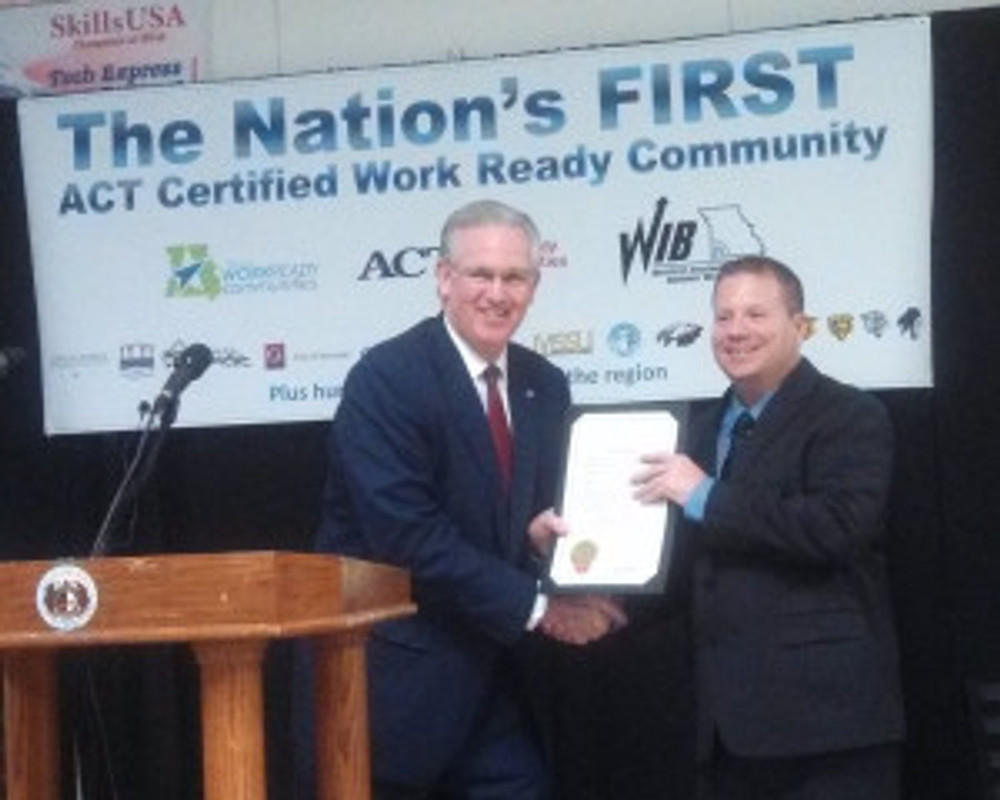Governor Jay Nixon presents the ACT Certified Work Ready Community certificate to Jasen Jones, executive director of the Workforce Investment Board of Southwest Missouri during ceremonies in Joplin March 8.