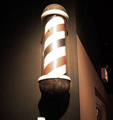 THE HISTORY OF THE BARBER POLE