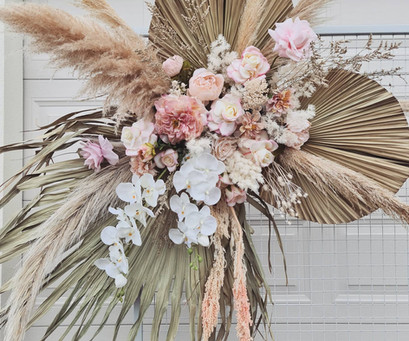 Boho dried and faux wall hanging / arbor arrangement.