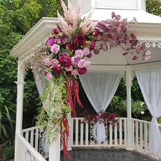 Burgundy corner arrangement. Faux flower large piece.