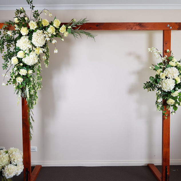 Wooden arch with cream artificial florals