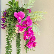 Faux planter hanger. Cerise orhcids, purple flowers and greenery.