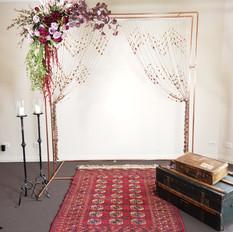 Copper arbor, burgundy corner arrangement.