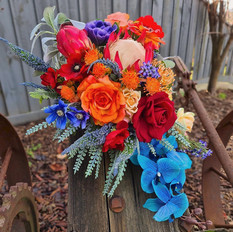 Artificial bold and bright cascading bridal bouquet.