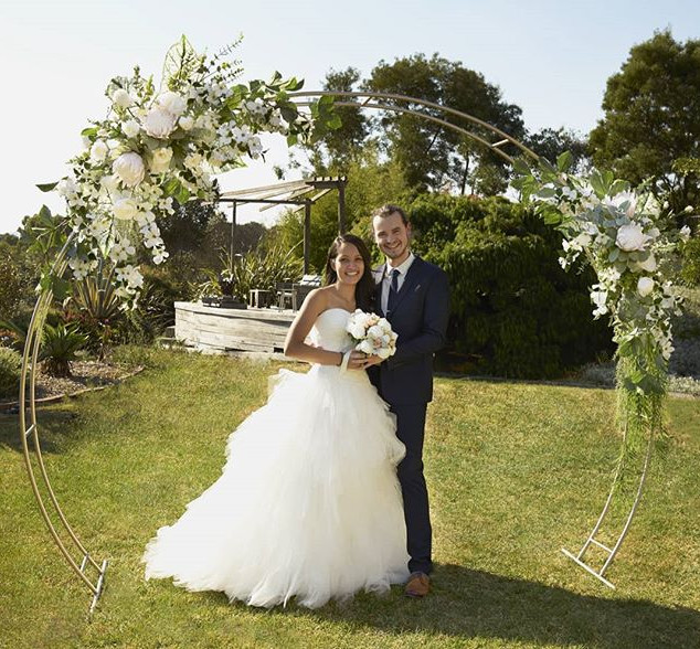 Champagne arch with white florals.jpg