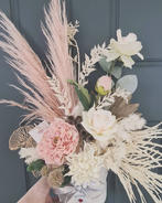Mixed dried and artificial arrangement in blush pink and ivory.