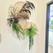 Wall hanging arrangement on 3 woven discs.