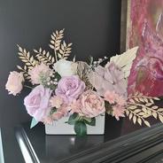 Rectangular faux flower arrangement. Mauve roses, blush roses, gold leaves and palmleaf.