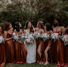 Wedding tribe. Peach, burned orange and cream wedding flowers.
