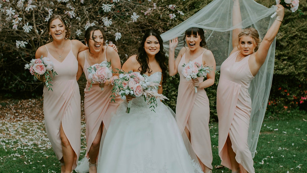Beautiful bride and her tribe showcasing faux bridal package in blush pink peonies and astilbe