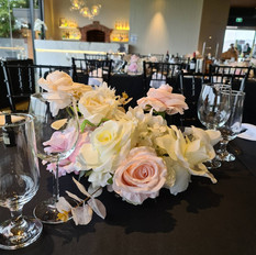 Center pieces in white and blush pink for the guests tables.