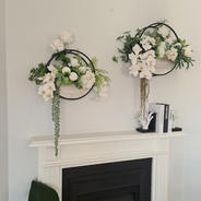 Wall planters with real touch roses, white orchids and greenery.