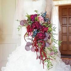 Faux flower burgundy cascading bridal bouquet.